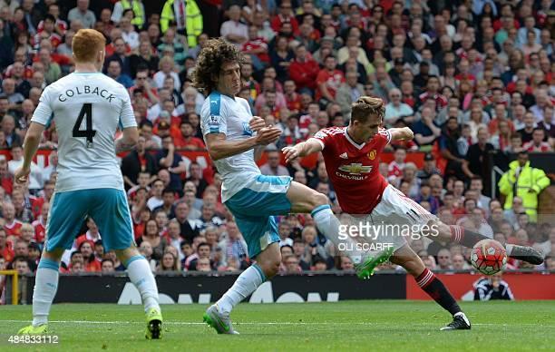 Newcastle United's Argentinian defender Fabricio Coloccini and Newcastle United's English midfielder Jack Colback defend as Manchester United's...
