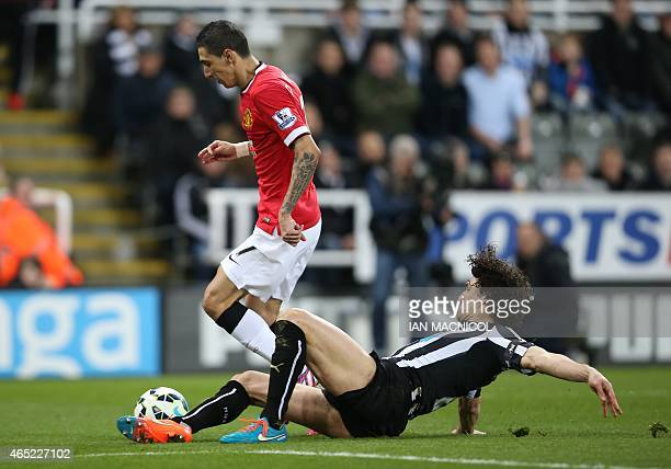 Newcastle United's Argentinian defender Fabricio Coloccini vies with Manchester United's Argentinian midfielder Angel Di Maria during the English...