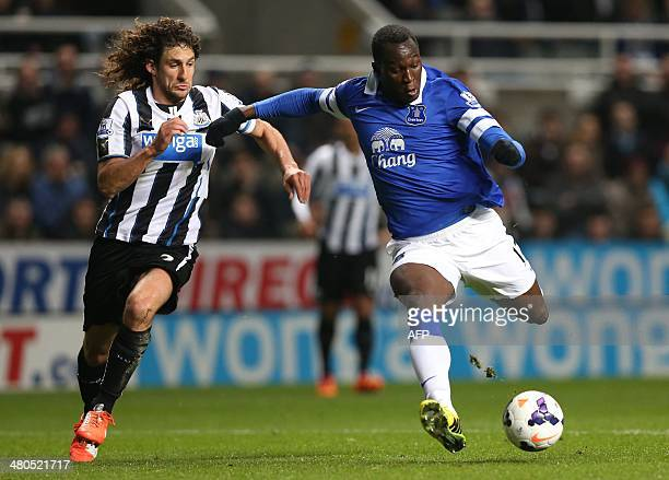 Newcastle United's Argentinian defender Fabricio Coloccini vies with Everton's Belgian striker Romelu Lukaku during the English Premier League...