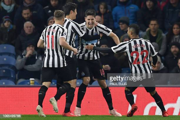 Newcastle United's Argentinian defender Federico Fernandez celebrates after his shot was deflected in off of Burnley's English defender Ben Mee to...