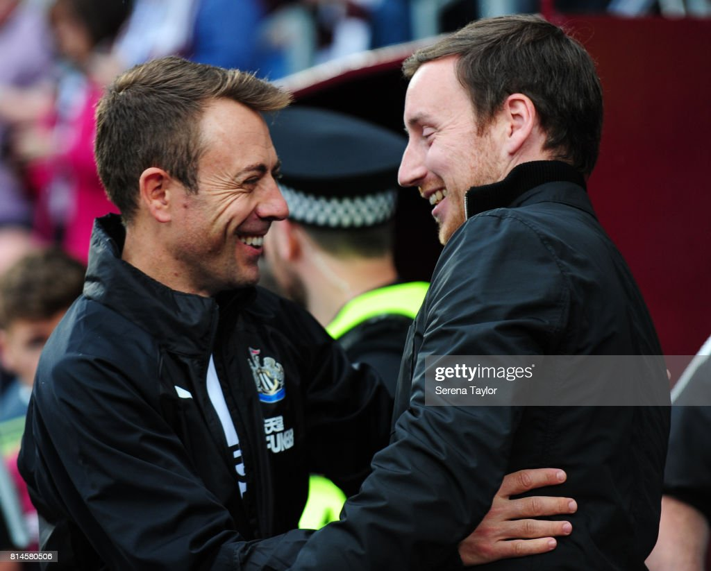 Newcastle United's Assistant Manager Francisco De Miguel Moreno (L) embraces Heart of Midlothian Manager Ian Cathro (R) during the Pre-Season Friendly between Heart of Midlothian and Newcastle United at the Tynecastle Stadium on July 14, 2017, in Edinburgh, Scotland.