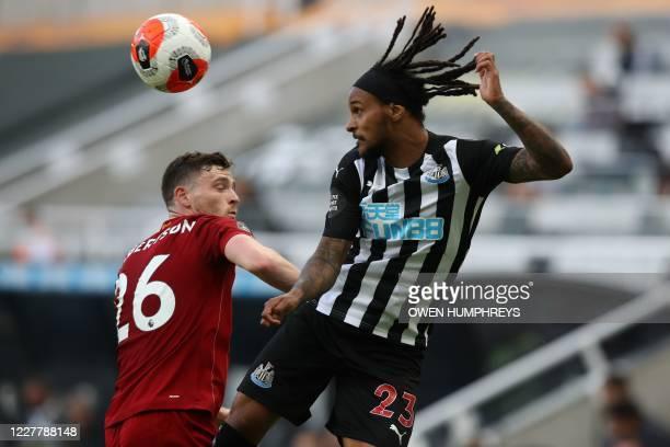 Newcastle United's Austrian midfielder Valentino Lazaro heads the ball next to Liverpool's Scottish defender Andrew Robertson during the English...