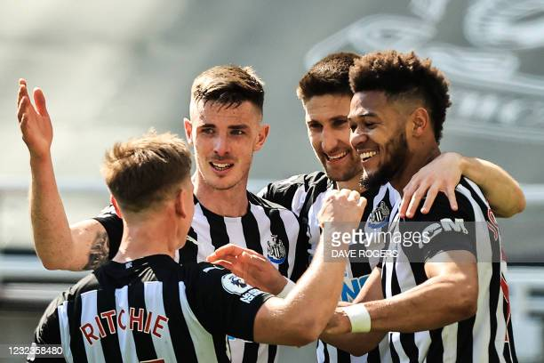 Newcastle United's Brazilian striker Joelinton celebrates with teammates after scoring a goal during the English Premier League football match...