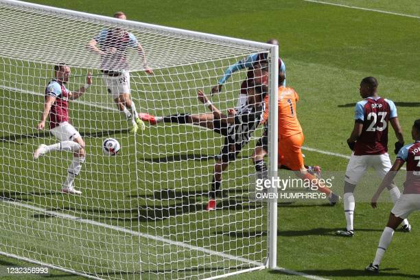 Newcastle United's Brazilian striker Joelinton shoots and scores a goal during the English Premier League football match between Newcastle United and...