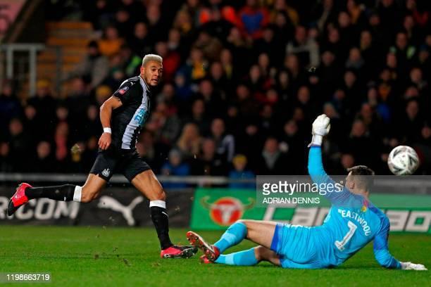 Newcastle United's Brazilian striker Joelinton shoots past Oxford United's English goalkeeper Simon Eastwood to score their second goal during the FA...