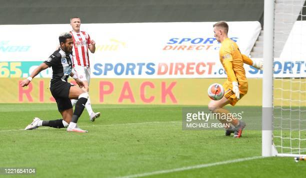 Newcastle United's Brazilian striker Joelinton shoots to score a goal past Sheffield United's English goalkeeper Dean Henderson during the English...
