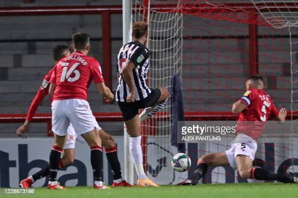 Newcastle United's Brazilian striker Joelinton shoots to score the opening goal of the English League Cup third round football match between...