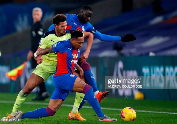 Newcastle United's Brazilian striker Joelinton vies with Crystal Palace's English defender Nathaniel Clyne and Crystal Palace's Senegalese midfielder...