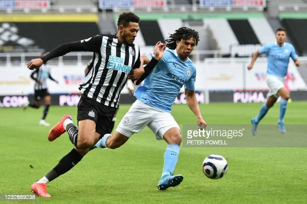 Newcastle United's Brazilian striker Joelinton vies with Manchester City's Dutch defender Nathan Ake during the English Premier League football match...