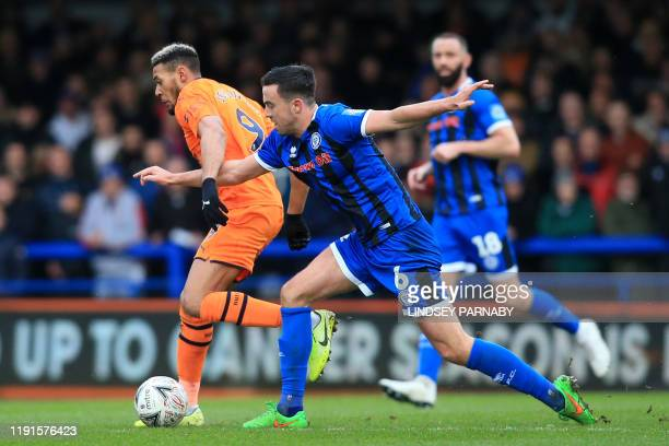 Newcastle United's Brazilian striker Joelinton vies with Rochdale's Irish defender Eoghan O'Connell during the English FA Cup third round football...