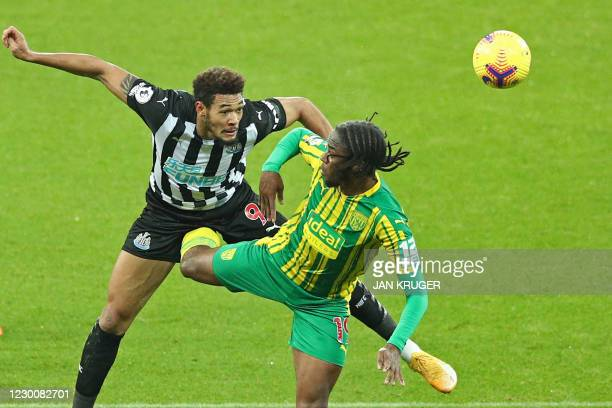 Newcastle United's Brazilian striker Joelinton vies with West Bromwich Albion's English-born St Kitts and Nevis midfielder Romaine Sawyers during the...