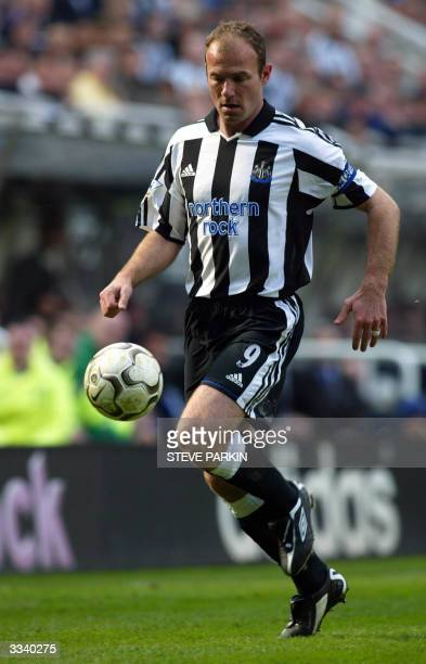 Newcastle United's captain Alan Shearer runs with the ball during their premiership clash against Arsenal at St James Park Newcastle 11 April 2004...