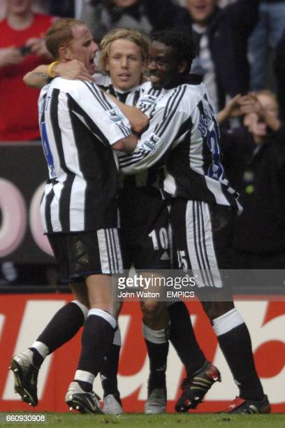 Newcastle United's Craig Bellamy is congratulated on scoring the winning goal by teammates Nicky Butt and Olivier Bernard