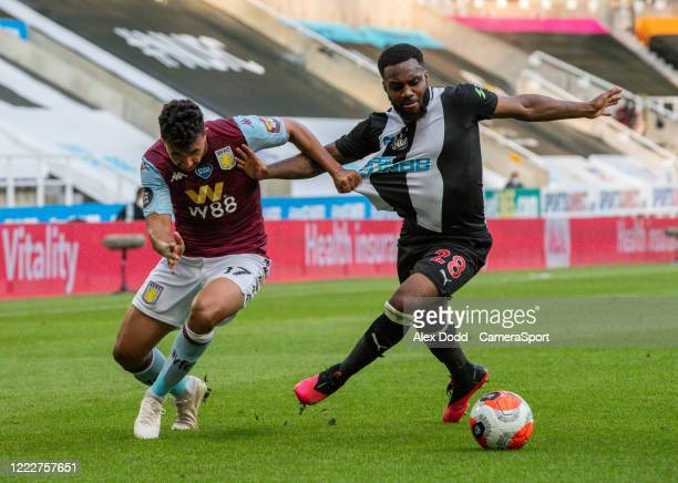 Newcastle United's Danny Rose battles with Aston Villa's Mahmoud Hassan during the Premier League match between Newcastle United and Aston Villa at...