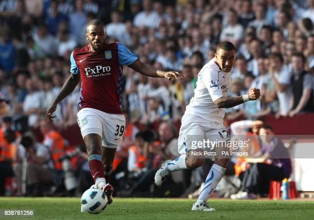 Newcastle United's Danny Simpson and Aston Villa's Darren Bent in action