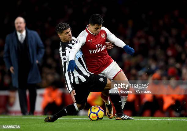 Newcastle United's DeAndre Yedlin and Arsenal's Alexis Sanchez battle for the ball during the Premier League match at the Emirates Stadium London