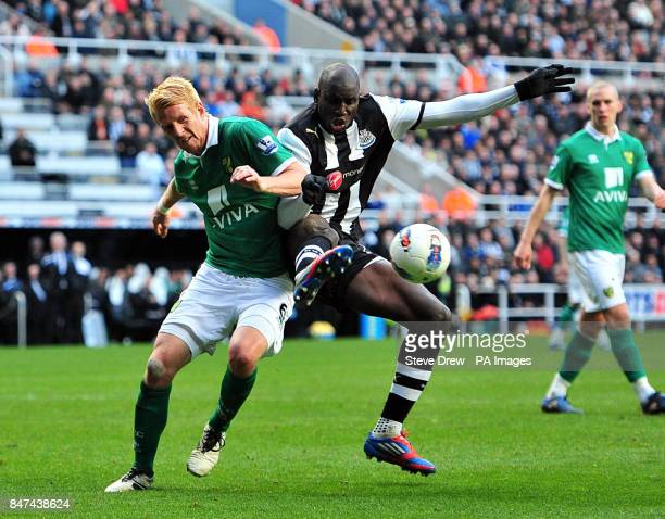 Newcastle United's Demba Ba and Norwich City's Zak Whitbread battle for the ball during the Barclays Premier League match at the Sports Direct Arena...
