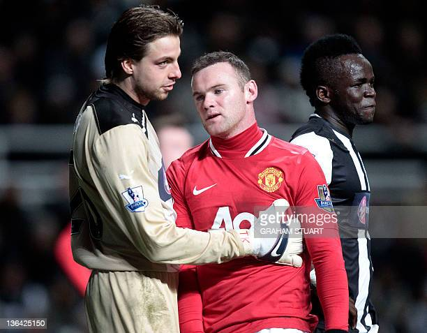 Newcastle United's Dutch goalkeeper Tim Krul reacts after stoping Manchester United's Wayne Rooney from scoring next to Ivorian midfielder Cheik...