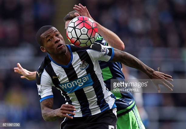 Newcastle United's Dutch midfielder Georginio Wijnaldum vies with Swansea City's Spanish defender Angel Rangel during the English Premier League...