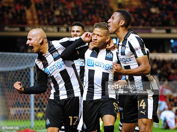 Newcastle United's Dwight Gayle centre celebrates scoring his sides first goal with teammates Jonjo Shelvey left and Isaac Hayden during the Sky Bet...
