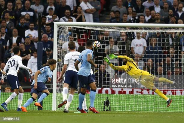 Newcastle United's English defender Jamaal Lascelles has a header saved by Tottenham Hotspur's French goalkeeper Hugo Lloris during the English...