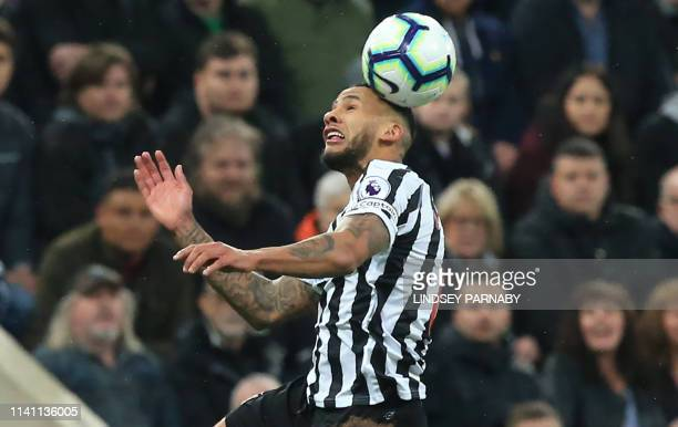 Newcastle United's English defender Jamaal Lascelles leaps the header the ball during the English Premier League football match between Newcastle...