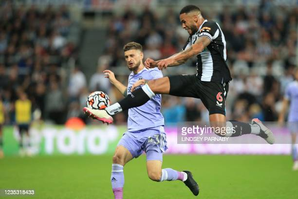 Newcastle United's English defender Jamaal Lascelles vies with Leeds United's Polish midfielder Mateusz Klich during the English Premier League...