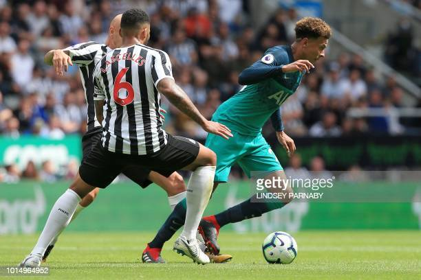 Newcastle United's English defender Jamaal Lascelles vies with Tottenham Hotspur's English midfielder Dele Alli during the English Premier League...