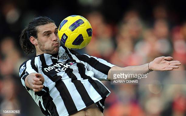 Newcastle United's English forward Andy Carroll brings the ball down on his chest during the game against Arsenal during the Premiership football...