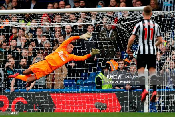 Newcastle United's English goalkeeper Karl Darlow cannot stop a freekick from Chelsea's Spanish defender Marcos Alonso making the score 30 during the...