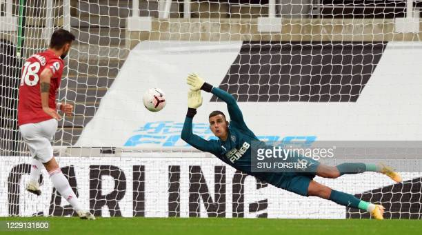 Newcastle United's English goalkeeper Karl Darlow saves a penalty from Manchester United's Portuguese midfielder Bruno Fernandes during the English...