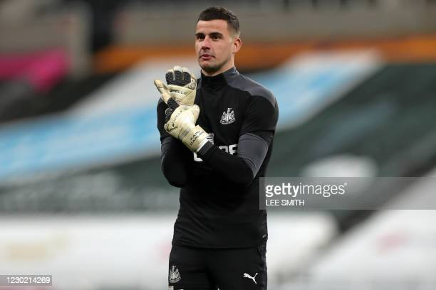 Newcastle United's English goalkeeper Karl Darlow warms up ahead of the English Premier League football match between Newcastle United and Fulham at...
