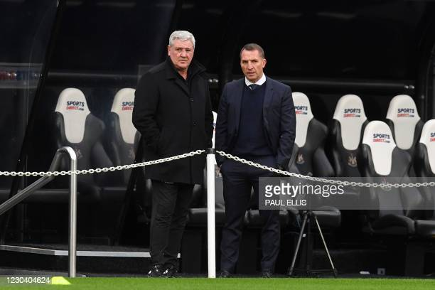 Newcastle United's English head coach Steve Bruce and Leicester City's Northern Irish manager Brendan Rodgers stand on the touchline ahead of the...