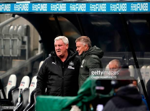 Newcastle United's English head coach Steve Bruce and Manchester United's Norwegian manager Ole Gunnar Solskjaer speak before the English Premier...