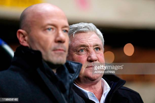 Newcastle United's English head coach Steve Bruce checks out the pitch conditions with former player and manager of Newcastle Alan Shearer ahead of...