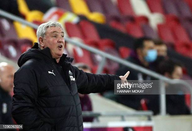 Newcastle United's English head coach Steve Bruce gestures during the English League Cup quarter final football match between Brentford and Newcastle...