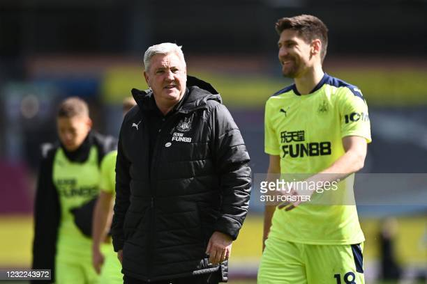 Newcastle United's English head coach Steve Bruce reacts after Newcastle United's Argentinian defender Federico Fernandez after winning the the...