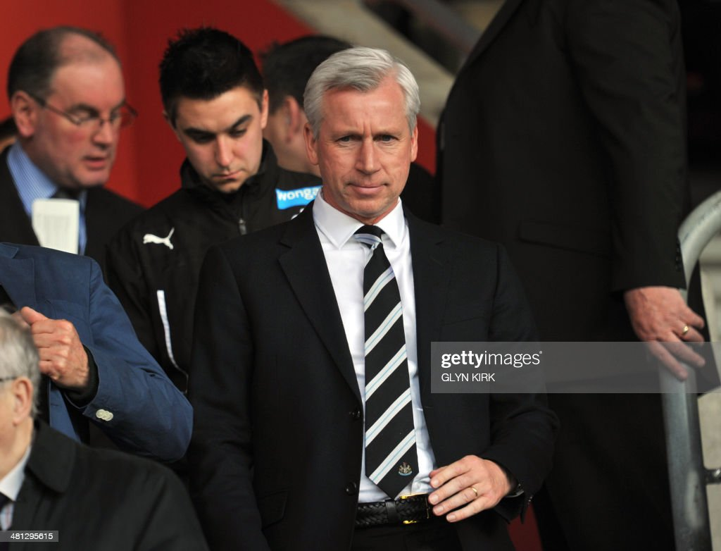 Newcastle United's English manager Alan Pardew takes his seat in the stands before the start of the English Premier League football match between Southampton and Newcastle United at St Mary's Stadium in Southampton, southern England on March 29, 2014. AFP PHOTO / GLYN KIRK USE. No use with unauthorized audio, video, data, fixture lists, club/league logos or live services. Online in-match use limited to 45 images, no video emulation. No use in betting, games or single club/league/player publications. /