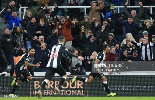 Newcastle United's English midfielder Isaac Hayden celebrates scoring his team's first goal during the English Premier League football match between...