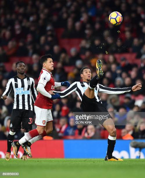 Newcastle United's English midfielder Isaac Hayden vies with Arsenal's Chilean striker Alexis Sanchez during the English Premier League football...