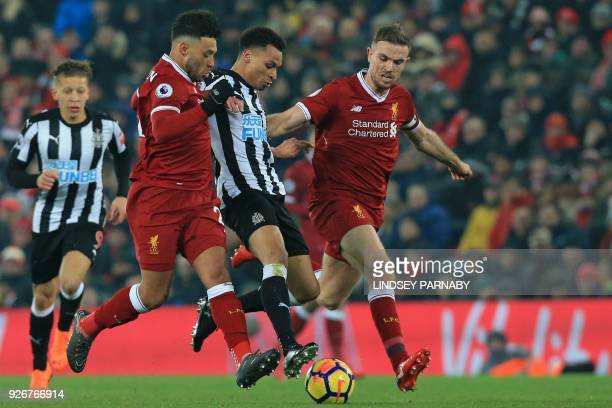 Newcastle United's English midfielder Jacob Murphy vies with Liverpool's English midfielder Alex OxladeChamberlain and Liverpool's English midfielder...