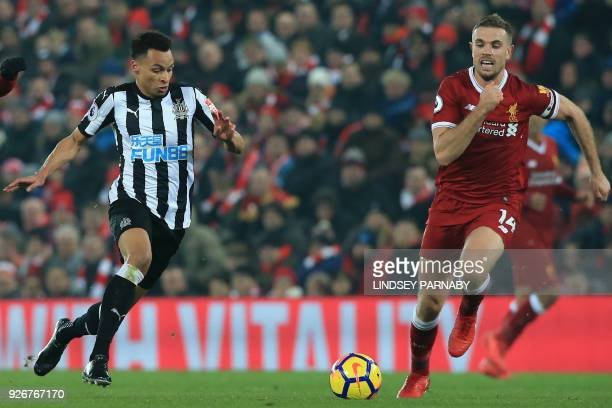 Newcastle United's English midfielder Jacob Murphy vies with Liverpool's English midfielder Jordan Henderson during the English Premier League...