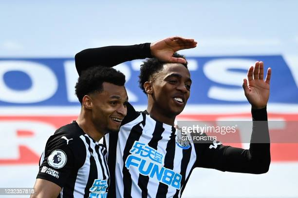 Newcastle United's English midfielder Joe Willock celebrates with teammate after scoring a goal during the English Premier League football match...