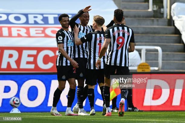 Newcastle United's English midfielder Joe Willock celebrates with teammates after scoring a goal during the English Premier League football match...