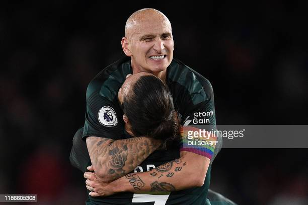 Newcastle United's English midfielder Jonjo Shelvey celebrates scoring his team's second goal with Newcastle United's English striker Andy Carroll...