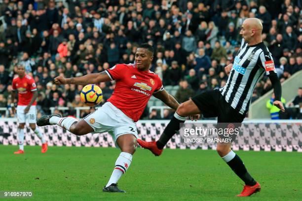 Newcastle United's English midfielder Jonjo Shelvey comes across to block Manchester United's Ecuadorian midfielder Antonio Valencia during the...