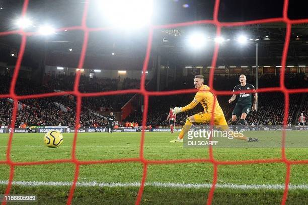 Newcastle United's English midfielder Jonjo Shelvey scores his team's second goal during the English Premier League football match between Sheffield...