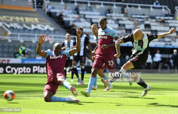 Newcastle United's English midfielder Jonjo Shelvey shoots and scores a goal during the English Premier League football match between Newcastle...