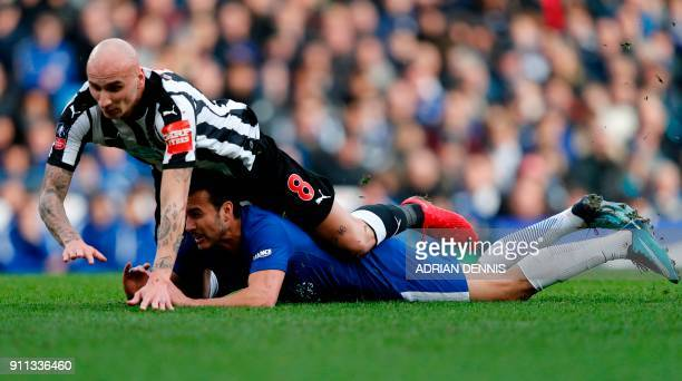 Newcastle United's English midfielder Jonjo Shelvey vies with Chelsea's Spanish midfielder Pedro during the English FA Cup fourth round football...