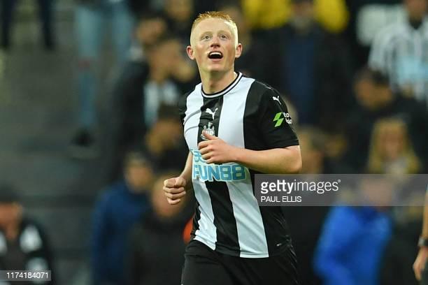 Newcastle United's English midfielder Matthew Longstaff celebrates after scoring the opening goal of the English Premier League football match...